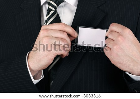 Business man adjusting his nametag - insert your own brand and iniformation - stock photo