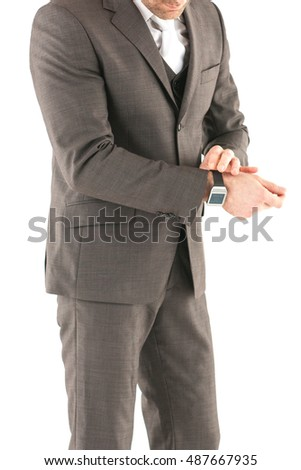 Business man adjusting his sleeve, on a white background, stock picture