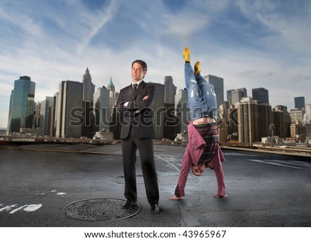 business man and a boy in headstand