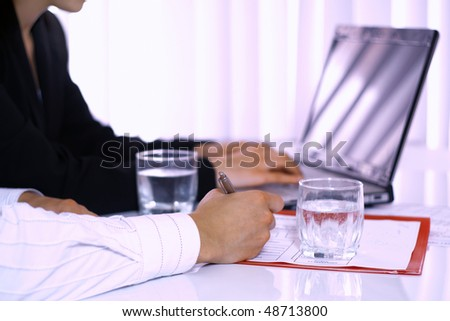 Business man and business woman making a treaty - stock photo