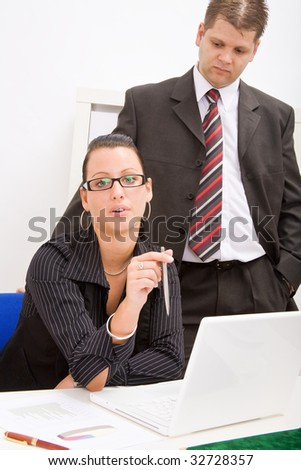 Business man and business woman working in office