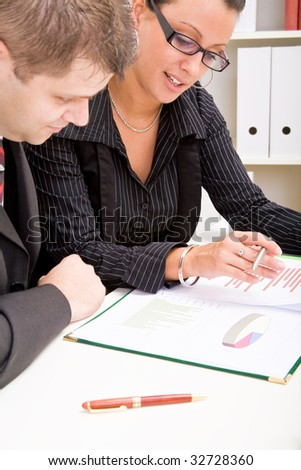 Business man and business woman working in office - stock photo