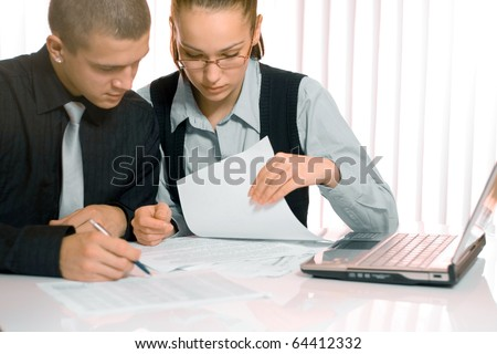Business man and business woman working together - stock photo