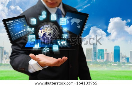 Business man and digital devices for working : Elements of this image furnished by NASA
