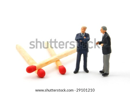 business man and matches isolated on white background - stock photo