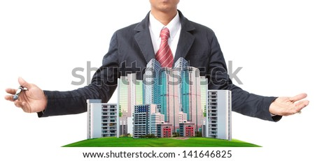 business man and modern building on green grass field use for land management theme - stock photo