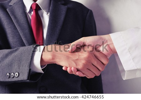 business man and researcher hand shake