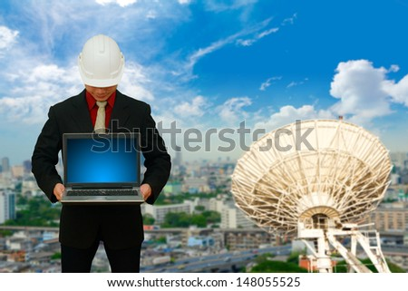 Business man and satellite background - stock photo