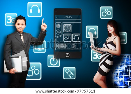 Business man and secretary look at icon from mobile phone : Elements of this image furnished by NASA