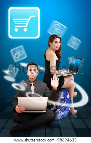 Business man and secretary look at the Cart icon from globe : Elements of this image furnished by NASA