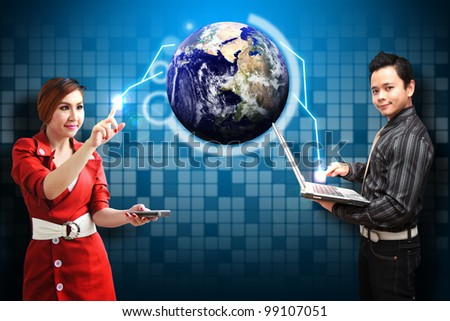 Business man and secretary look at the world : Elements of this image furnished by NASA