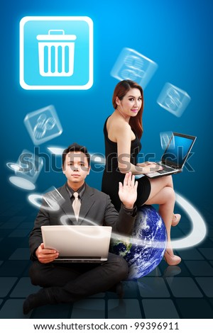 Business man and secretary present the bin icon from globe : Elements of this image furnished by NASA