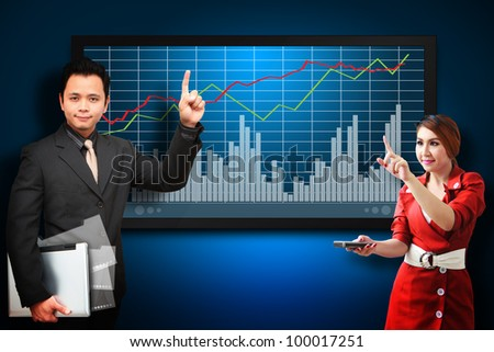 Business man and secretary present the stock exchange graph report - stock photo