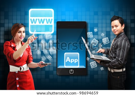 Business man and Secretary touch the world wide web icon from mobile phone