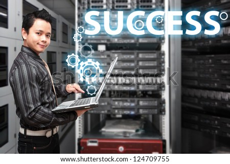 Business man and success gears in data center room - stock photo