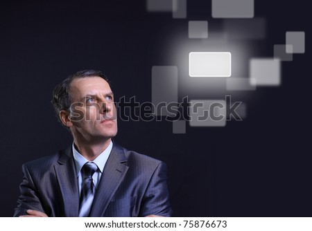 Business man and virtual button - stock photo