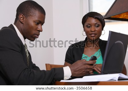 business man and woman at table - stock photo