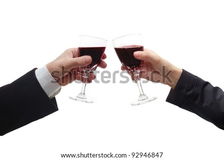 Business man and woman celebrate with red wine
