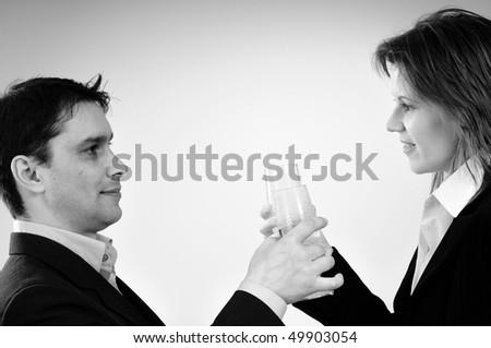 business man and woman celebrating success - stock photo
