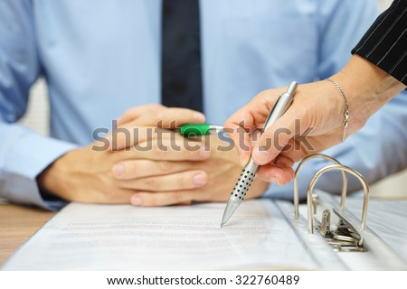 business man and woman checking proposal of contract - stock photo