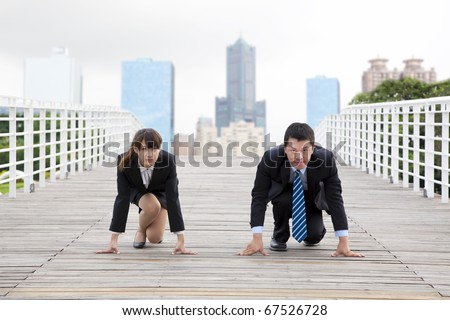 Business man and woman  getting ready for race in business - stock photo