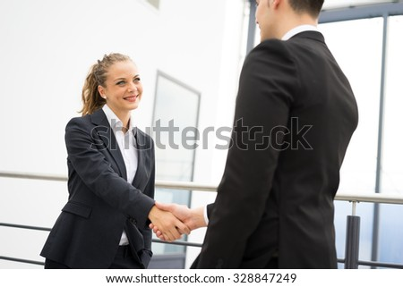 Business man and woman handshake at office