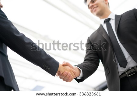 Business man and woman handshake at office - stock photo