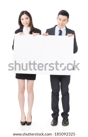 Business man and woman holding blank white board, full length portrait isolated on white background. - stock photo