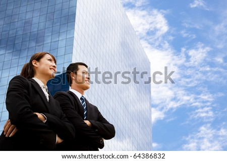 business man and woman  looking away - stock photo