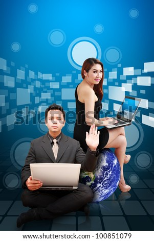 Business man and woman on digital background : Elements of this image furnished by NASA