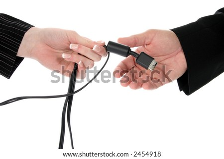 Business man and woman passing cable over white background.