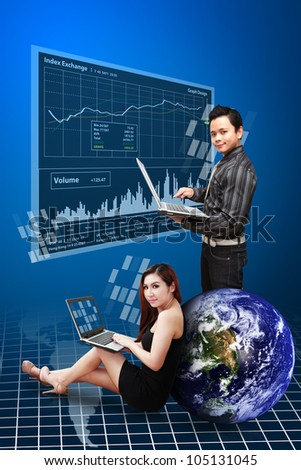 Business man and woman present the stock graph report : Elements of this image furnished by NASA - stock photo