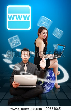 Business man and woman present World Wide Web icon : Elements of this image furnished by NASA - stock photo