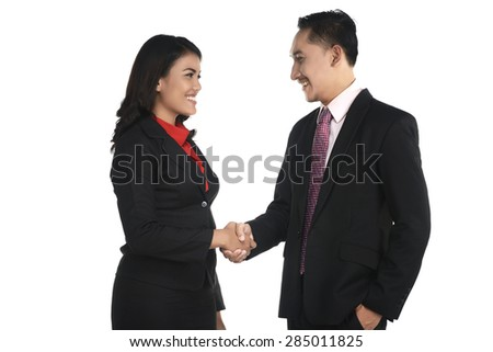 Business man and woman shake hand isolated over white background - stock photo