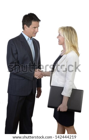 Business man and woman shaking hands, Studio Shot