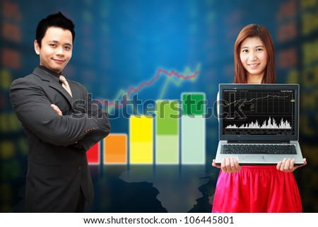 Business man and woman show the graph
