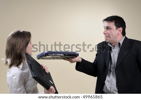 business man and woman simulating conflict - stock photo