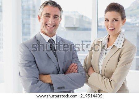 Business man and woman smiling while in the office - stock photo
