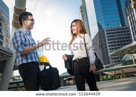 Business Man and Woman talking or Conversation Outdoor in Modern City as Business Communication Concept
