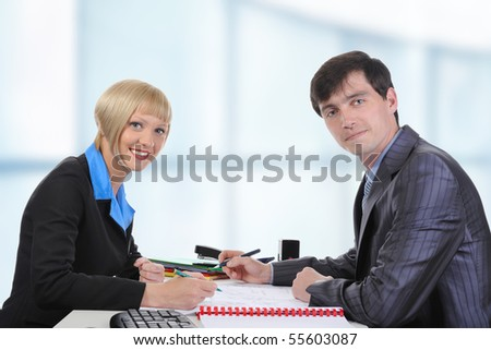 Business man and woman when signing documents. - stock photo