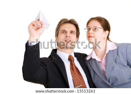 business man and woman with paper airplane in hands - stock photo