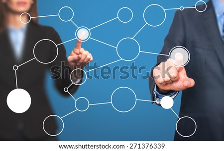 business man and women hand drawing blank flow chart on new modern computer as concept. Isolated on blue. Stock Image - stock photo
