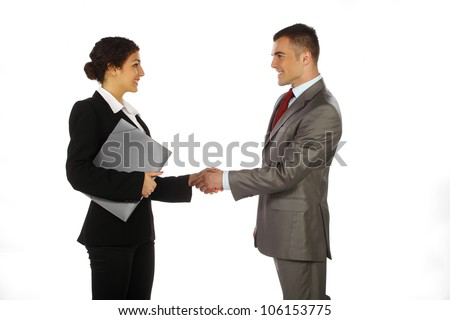 Business man and women standing and shaking hands - stock photo
