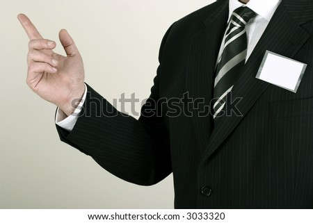Business man at a convention with a blank nametag - insert your own brand or information - stock photo