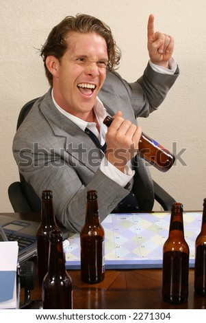 Business man at desk with empty beer bottles. - stock photo