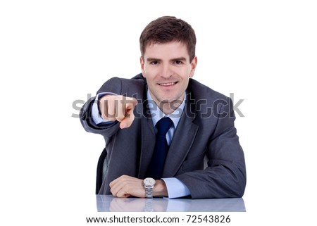 business man at his desk pointing , on a white background - stock photo