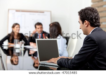 Business man at the office with a laptop - stock photo