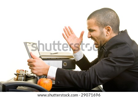 Business man at work screaming at his laptop - stock photo