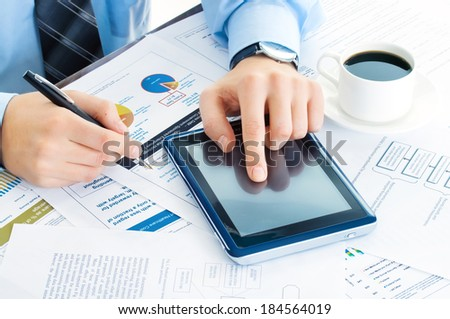 business man at workplace with tablet pc - stock photo