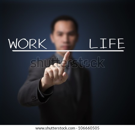 business man balance his work and life by finger tip - stock photo